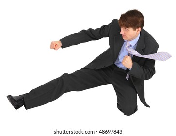 Businessman kicks forward, isolated on a white background