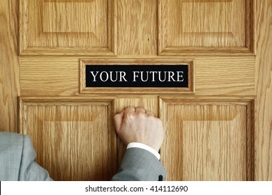 """Businessman knocking on a door to """"Your Future"""" office concept for aspirations, progress meeting or promotion"""