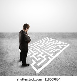 businessman and labyrinth with arrow