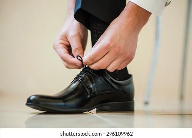 Businessman lace up black shoes