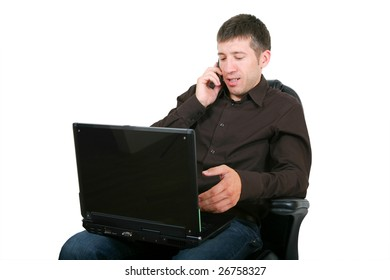 Businessman with laptop calling on by phone