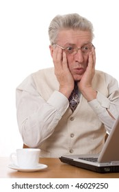 businessman with laptop holding his head