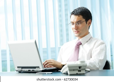 Businessman with laptop at office