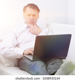 businessman with laptop works in the room