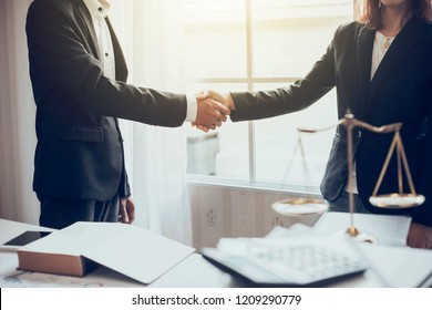 Businessman and lawyer shaking hands.