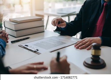 Businessman and lawyer sign the contract, the agreement in the document.