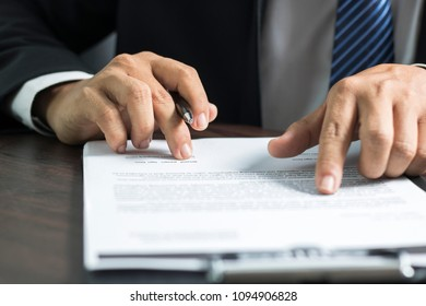 businessman or lawyer signing on contract paper on table in office, concept as insurance and manager