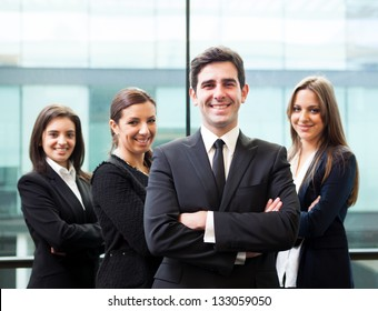 Businessman leader on the foreground of his team