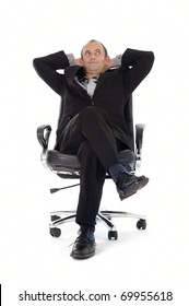 businessman leaning back in his desk chair