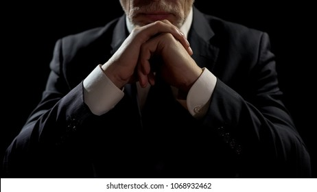 Businessman leaning on elbows, professional lawyer listening patiently to client