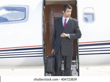 A businessman leaving a plane