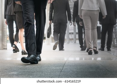 businessman legs walking go forward as outstanding by other legs walking as opposite direction on business street