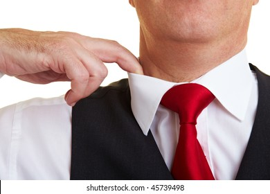 Businessman lifting the collar with his finger