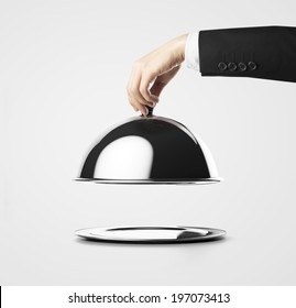 Businessman lifting the lid of the tray