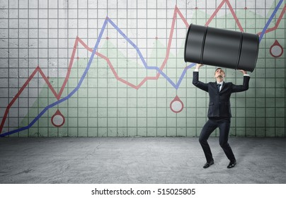 Businessman lifts up a barrel of oil on the background of the rising graph. Speculation. Rise in oil prices. Raising rates. Stock market. Investment and finance.