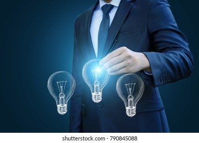 Businessman lights a lamp drawn. The concept ideas during the work.