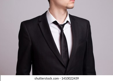 Businessman with a little beard in a black suit with a black tie