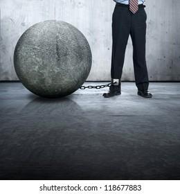 businessman lock with stone ball