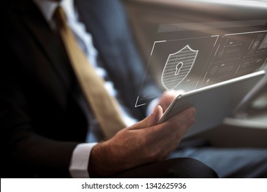 Businessman logging in to his tablet