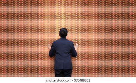 Businessman look at brick wall. Stalemate. Problem.
