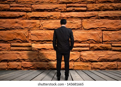 Businessman look brick wall,Reached an impasse,Stalemate