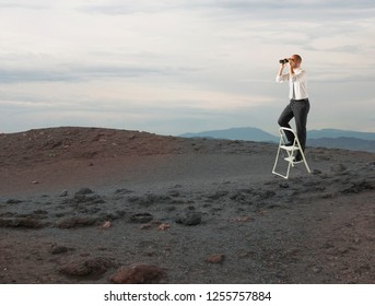 Businessman look far for new business opportunities with a telescope