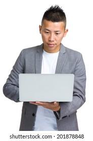 Businessman look at notebook computer
