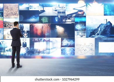 Businessman looking at abstract digital picture gallery. Multimedia and communication concept
