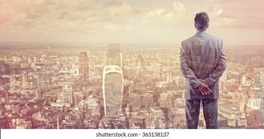 Businessman looking across the city of London financial district concept for entrepreneur, leadership and success