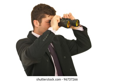 Businessman looking away through binocular isolated on white background
