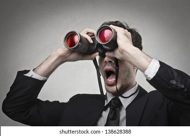 businessman looking with binoculars