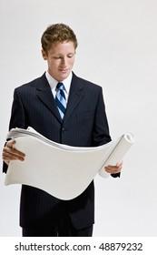 Businessman looking at blueprints