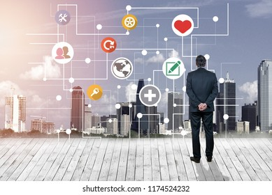 Businessman looking at business concept against modern city background