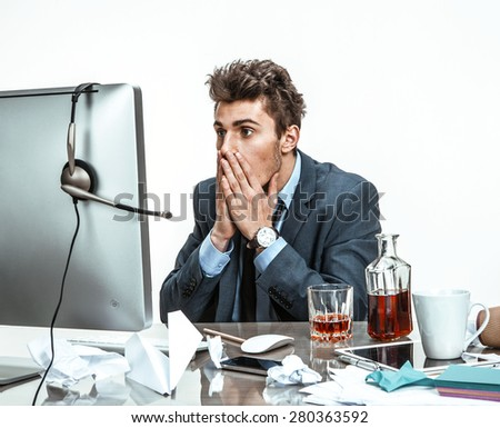 Businessman looking at computer screen with horror / modern office man at working place, depression and crisis concept