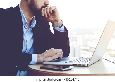 Businessman looking concerned with results of last meeting with investors. Experienced entrepreneur must to make immediate decision in necessary to stop the further disintegration of his company