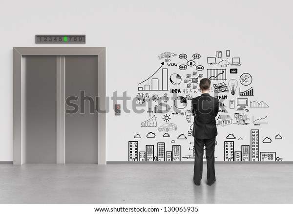 businessman looking at drawing business plan