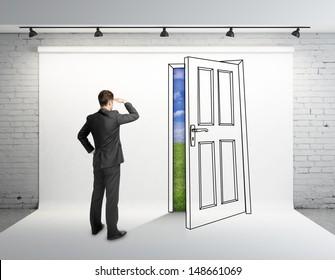 businessman looking at drawing door