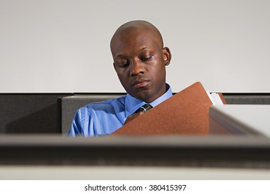 Businessman looking at files