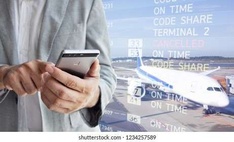 Businessman looking at flight schedules on mobile  People and lifestyles concept. Travel and Happy life of single theme. Businessman with mobile phone in international airport checking at the flight i