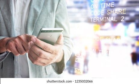 Businessman looking at flight schedules on mobile  People and lifestyles concept. Travel and Happy life of single theme. Businessman with mobile phone in international airport checking at the flight.