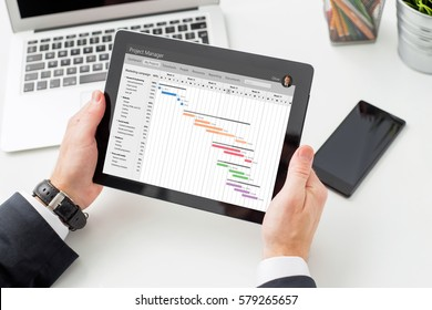 Businessman looking at Gantt chart on tablet computer
