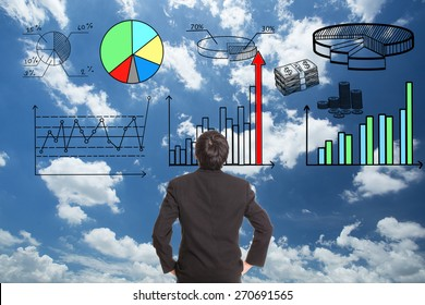 Businessman looking growing graph in stock marketing.