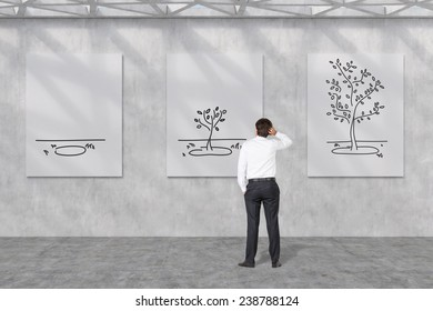 businessman looking to growing tree on poster