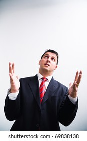 Businessman looking up for help