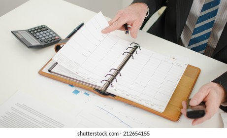 Businessman looking at his diary for take an appointment