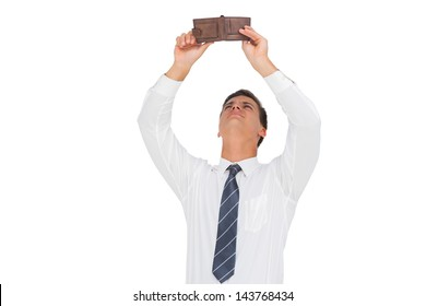 Businessman looking at his empty wallet on white background