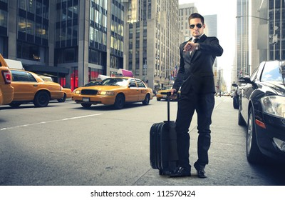 Businessman looking at his watch in New York