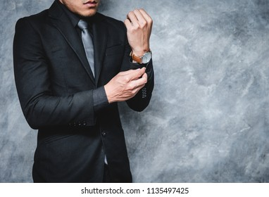 businessman looking at his watch on his hand, watching the time,Business concept