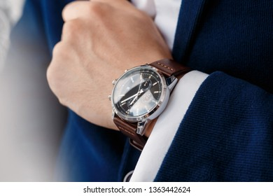businessman looking at his watch on his hand, watching the time closeup watch on hand businessman, he checking time on watch, dark ton