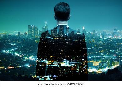 Businessman looking at illuminated night city. Double exposure